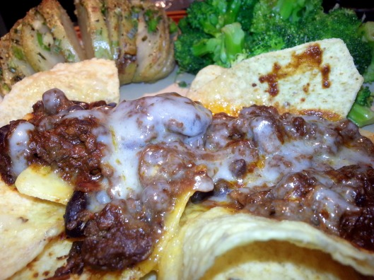 Chili on Chips with melted emmentaler cheese, potato, and broccoli